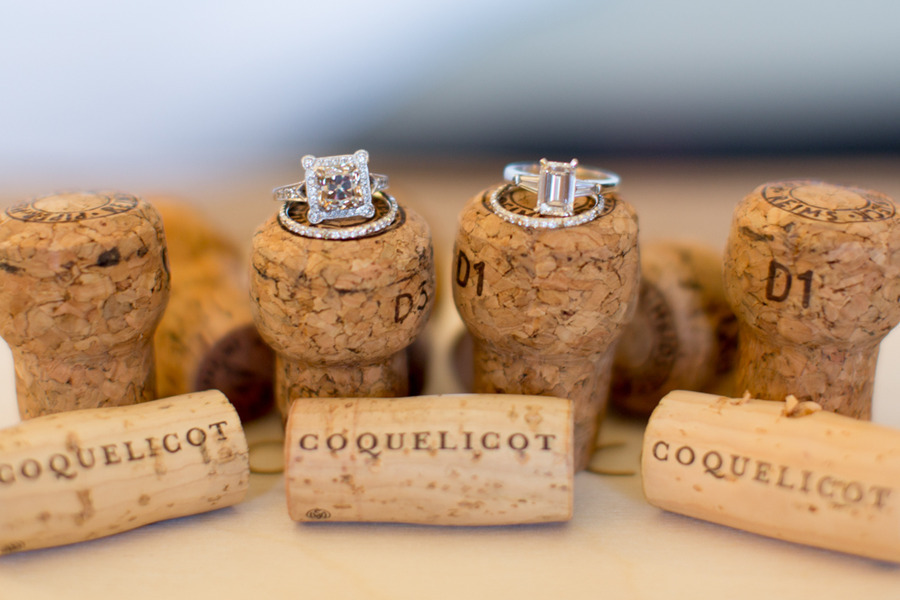 Engagement-rings-wedding-bands-atop-champagne-corks.full
