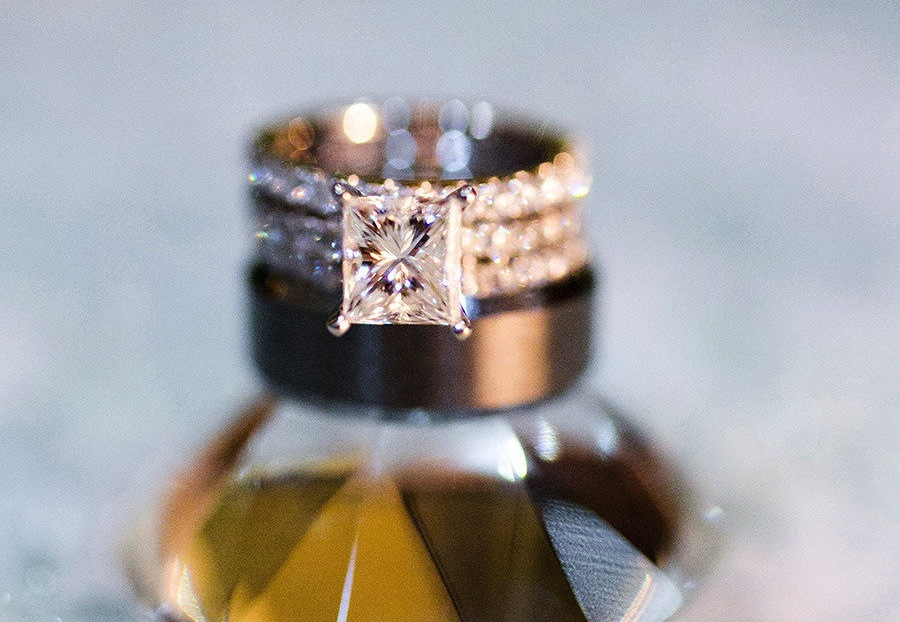 Iced out engagement ring shot