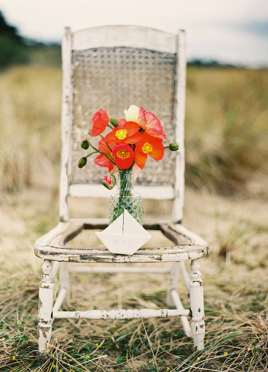 bright orange wedding centerpiece via Style Me Pretty