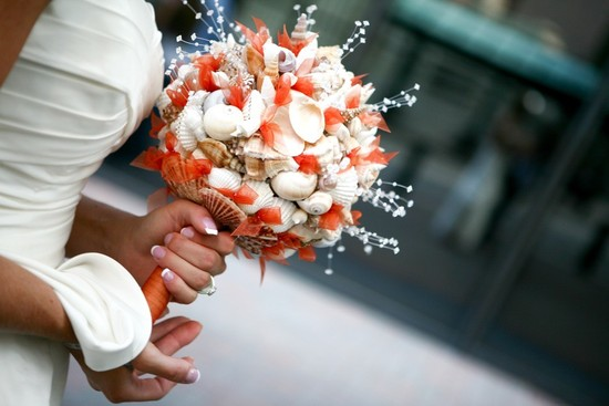 Orange and ivory seashell wedding bouquet
