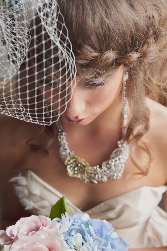 Braided wedding hairstyle with chic birdcage veil