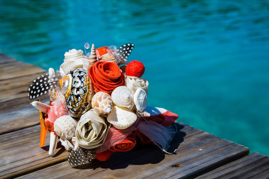 Bright shell and feather bridal bouquet