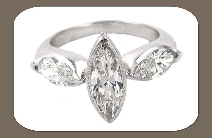 3-stone-marquis-diamond-engagement-ring.full