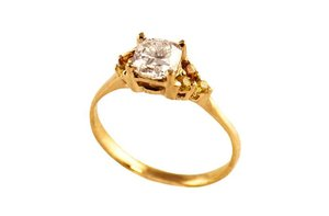 photo of gold diamond engagement ring raw diamonds