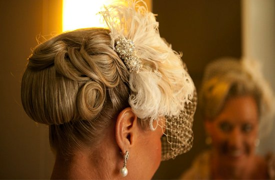 retro wedding hairstyle finger roll updo