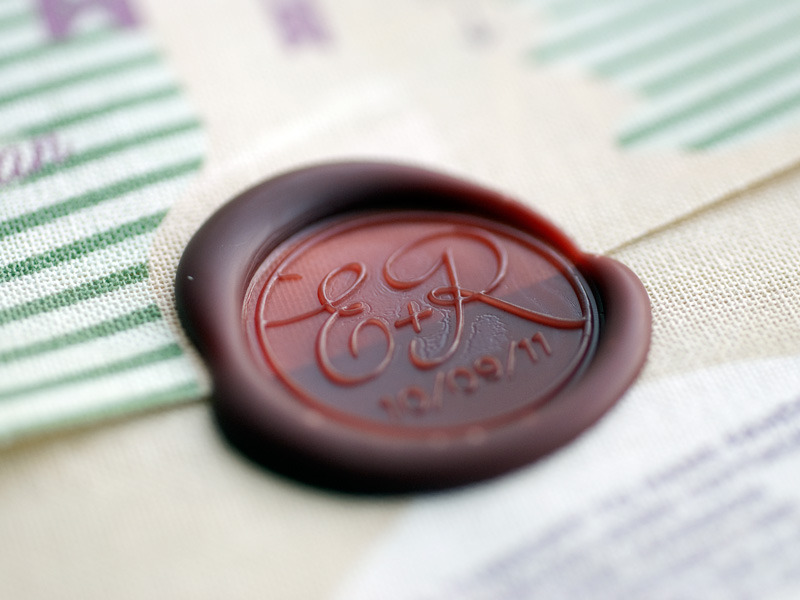 Monogrammed wax seal on wedding invitations