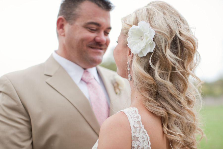 Curly-half-up-wedding-updo-with-flower.full