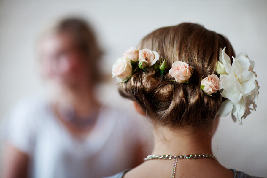 Twisted bohemian wedding hairstyle with roses