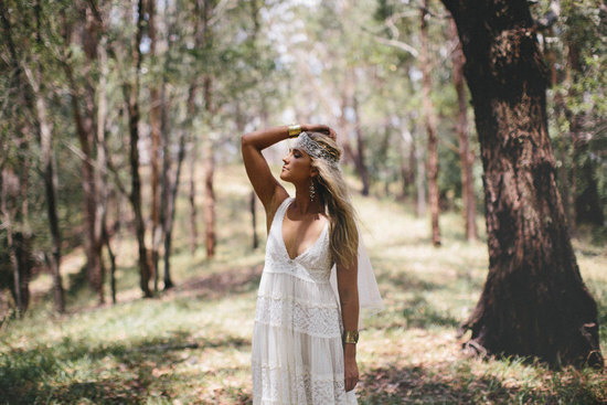 Boho chic bride wears ivory v neck wedding dress