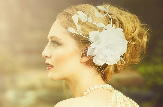 vintage inspired bridal headpiece with flower and feathers