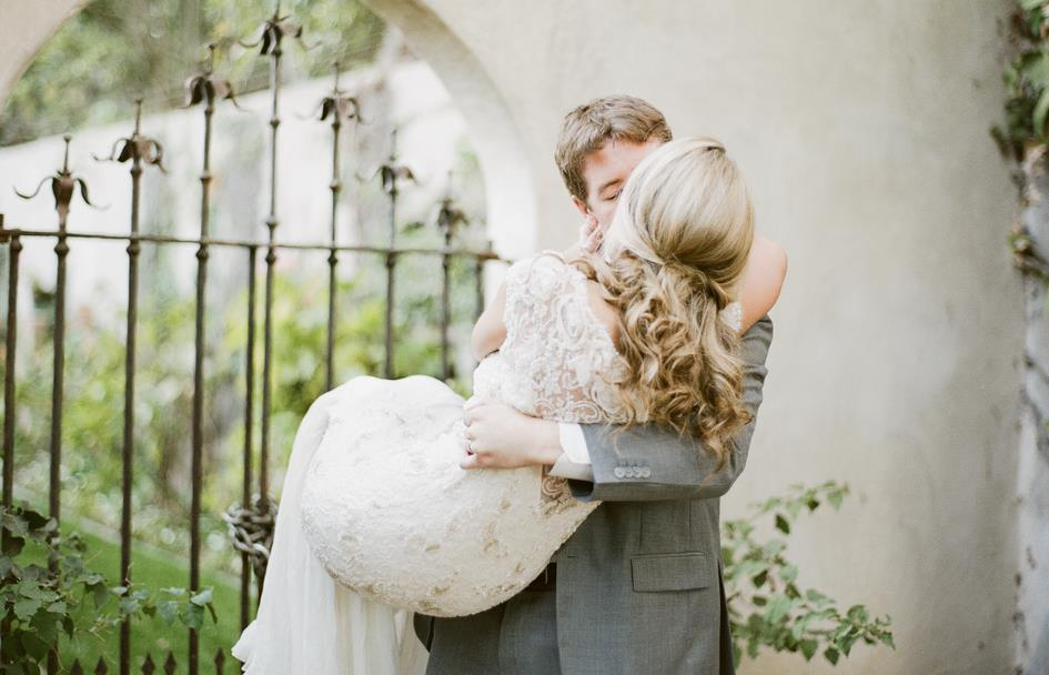 Bride-wears-half-up-wedding-hairstyle-sarah-janks-bridal-gown.full