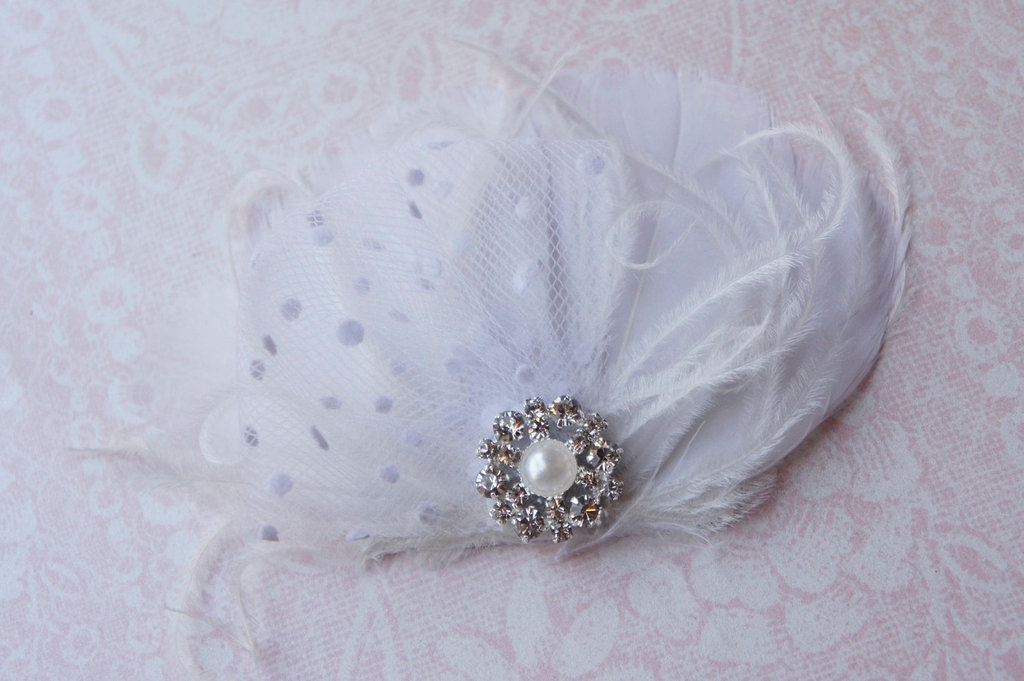 Dotted tulle and feather wedding fascinator