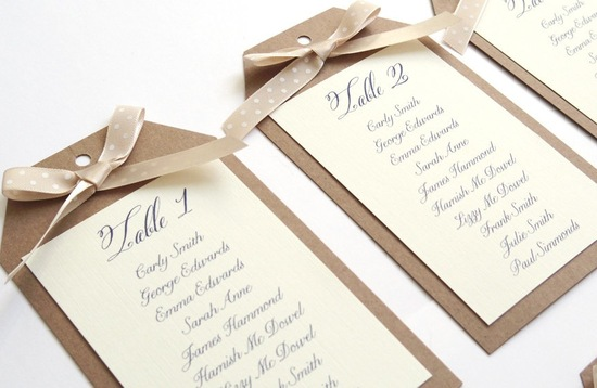 Ribbon tied wedding escort card table numbers
