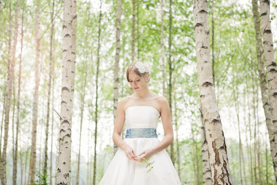 Strapless wedding dress with blue dotted sash