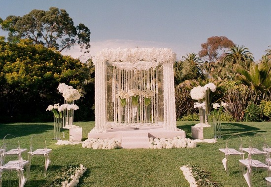 all white wedding ceremony flowers altar