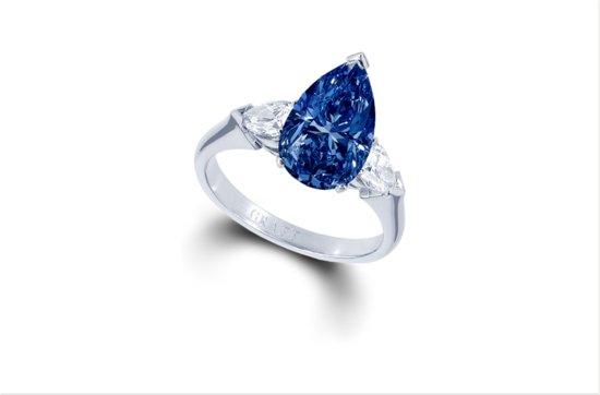 photo of Deep blue pearshape diamond engagement ring 3 11 ct