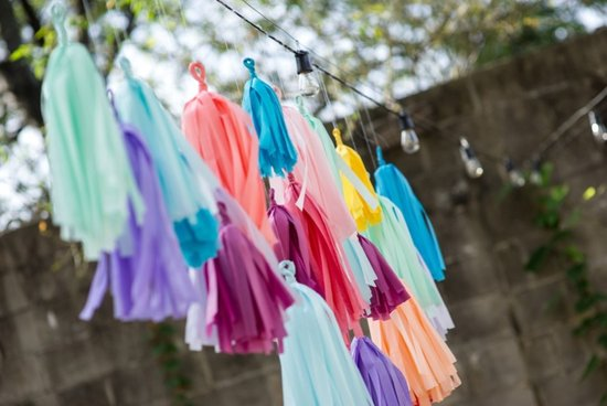 Simple wedding DIYs to try rainbow tassle garland