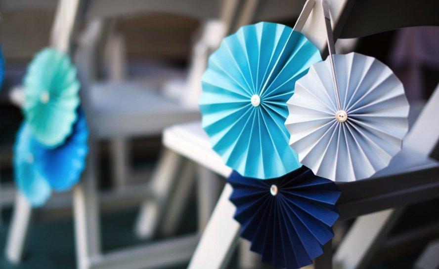 Shades-of-blue-accordian-wedding-chair-decor.full