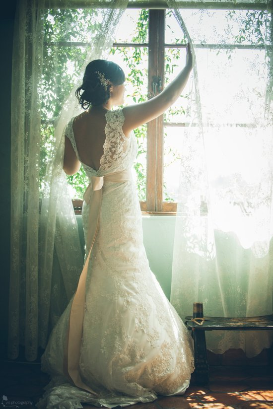 Romantic bride shows off lace low back wedding dress