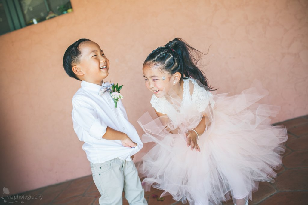 Adorable-flower-girl-and-ring-bearer-laughing.full
