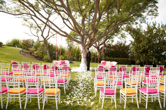 Outdoor wedding orange pink chair cushions