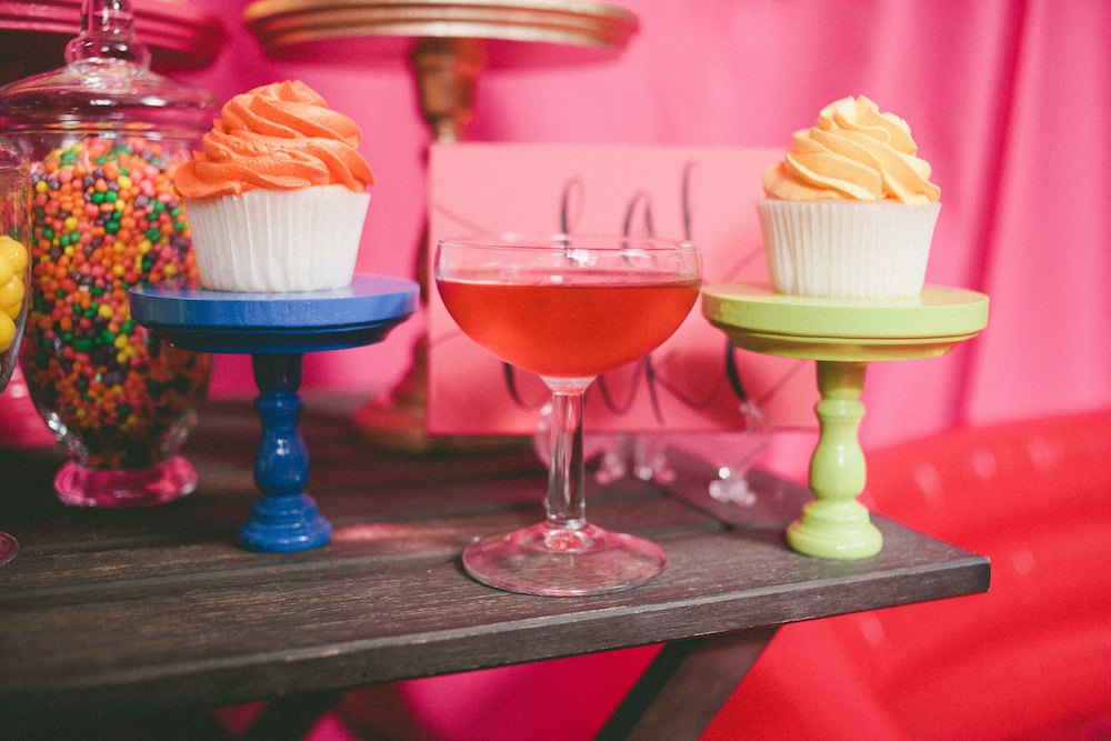 Bright wedding cupcake and cocktail display