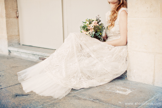 romantic lace wedding dress and bouquet all down wedding hair
