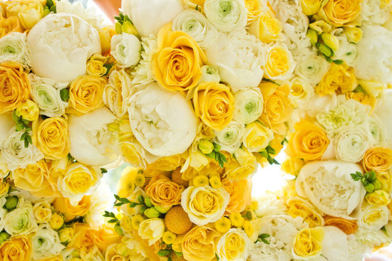 Sunny yellow and elegant ivory wedding flowers