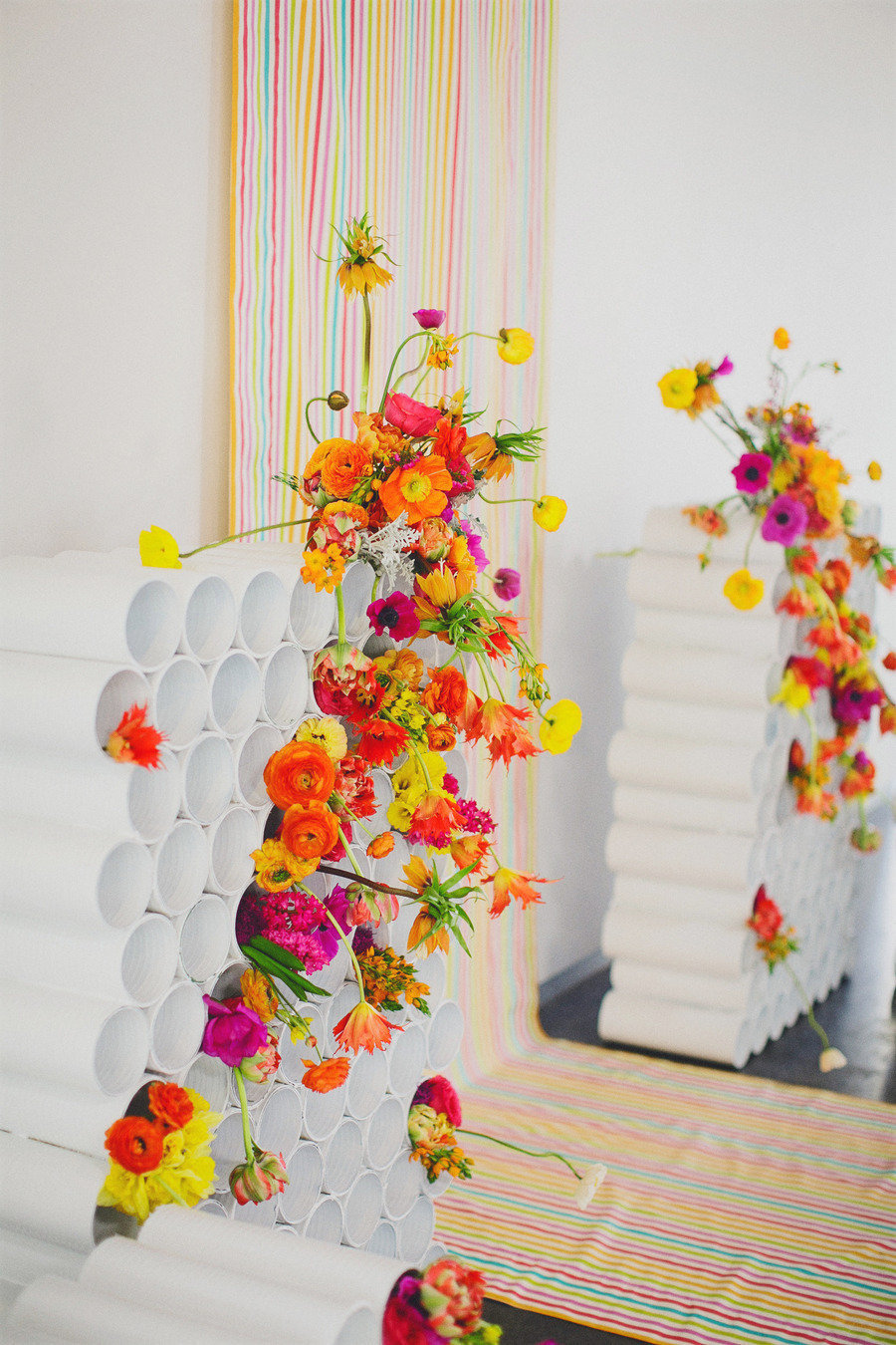 Rainbow-neon-wedding-backdrop-with-bright-bold-flowers.full