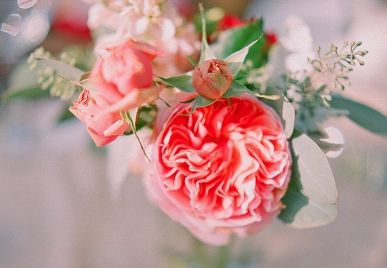 Bright coral garden rose wedding centerpiece