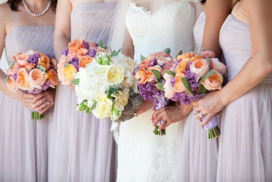 peach purple bridesmaids bouquets with bride in ivory