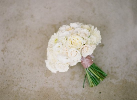 classic ivory wedding bouquet tied with taupe ribbon