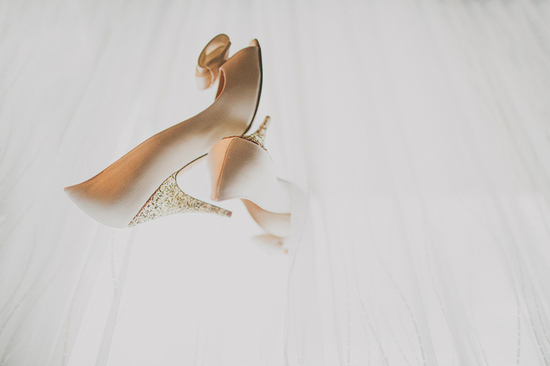 photo of blush satin wedding shoes with sparkly gold heels