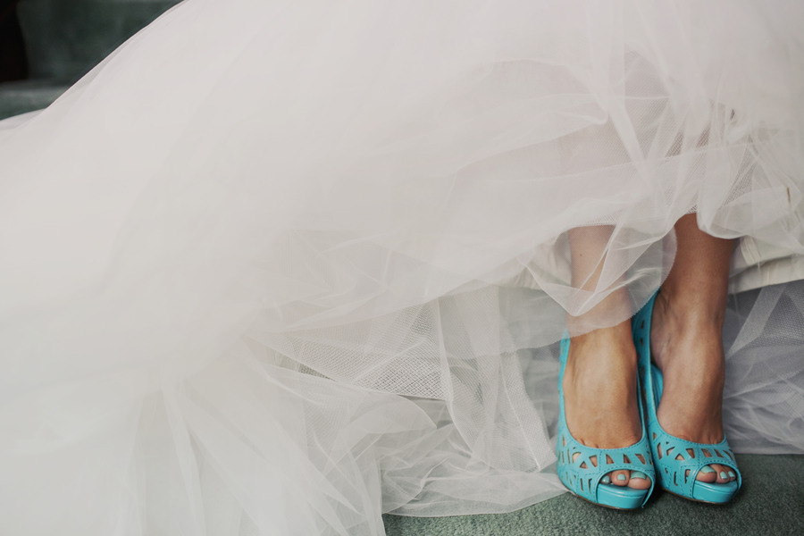Ivory tulle wedding dress paired with light blue heels and for Blue shoes for wedding dress