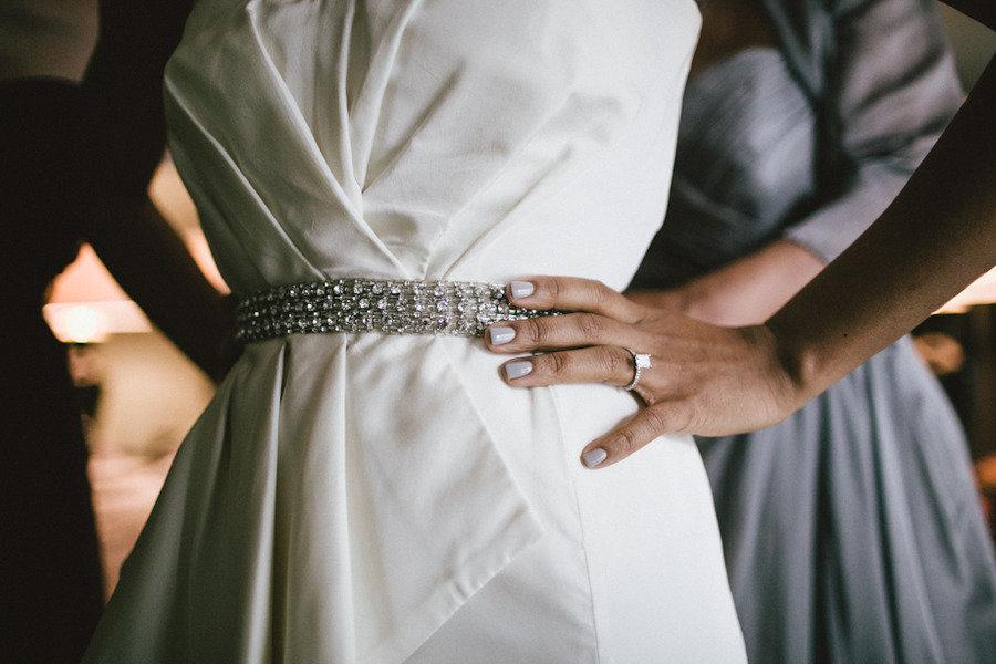 Bride-getting-ready-oscar-de-la-renta-gown-with-crystal-sash.full