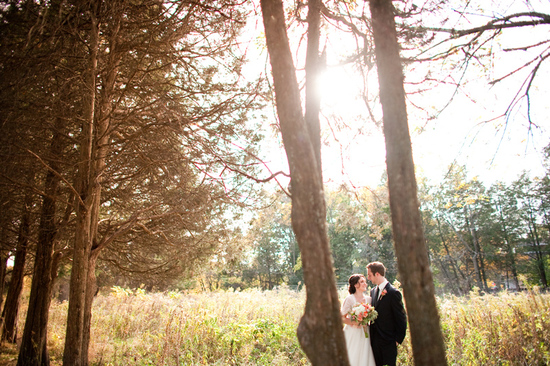 rustic barn wedding IL photographers bride and groom in woods