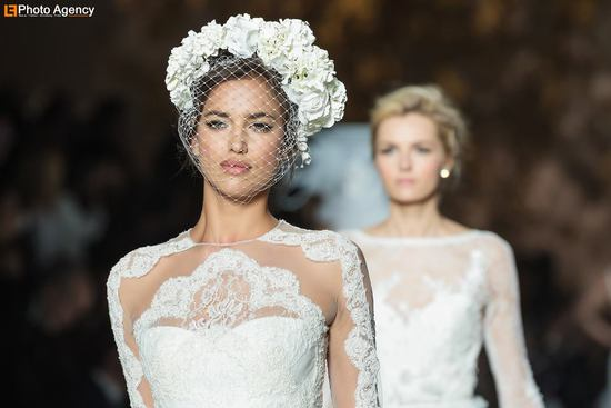 Pronovias bride wears floral crown with classic bridal blusher