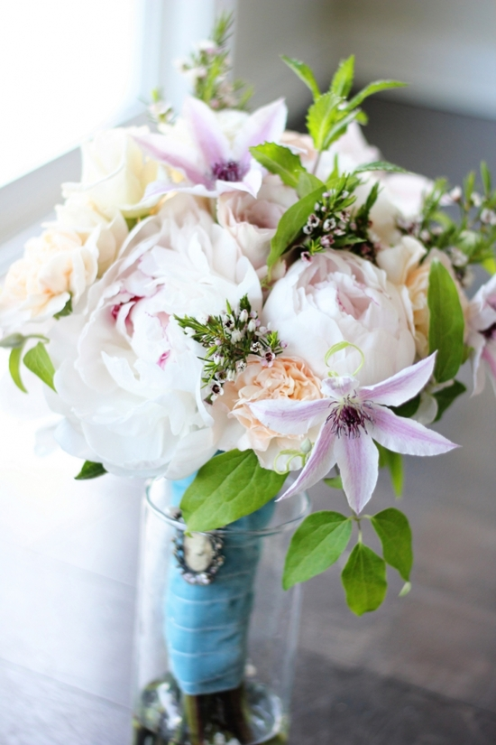 Summer wedding bouquet with clematis and peonies