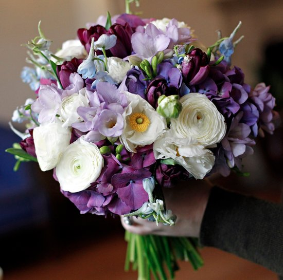 purple and white wedding bouquet with delphinium