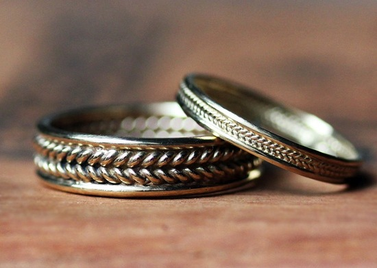 Yellow gold braided wedding bands for bride and groom