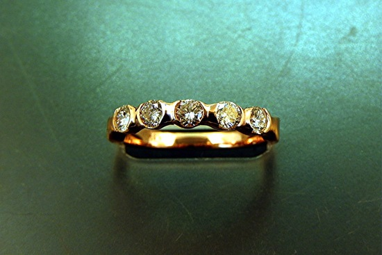 gold five stone diamond wedding band modern design