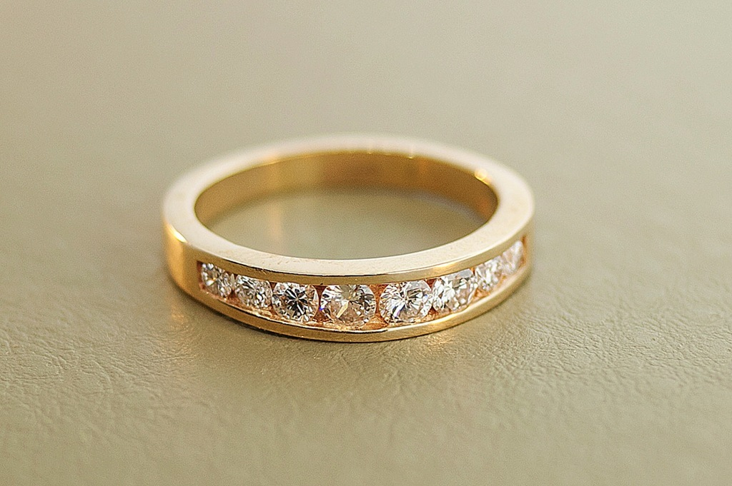 yellow gold thick wedding band with channel set diamonds