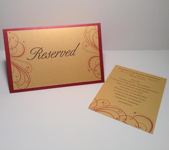 Burgundy and gold reserve sign and reception itinerary