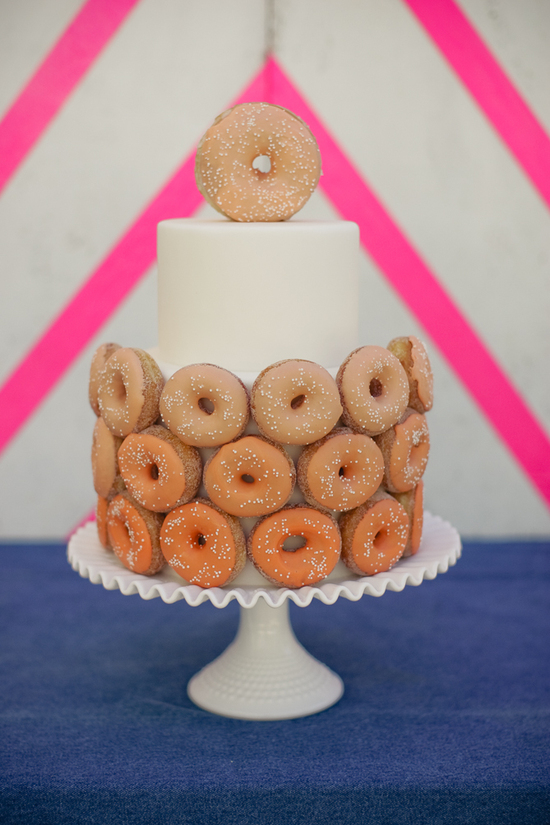 Unique wedding cake adorned with donuts