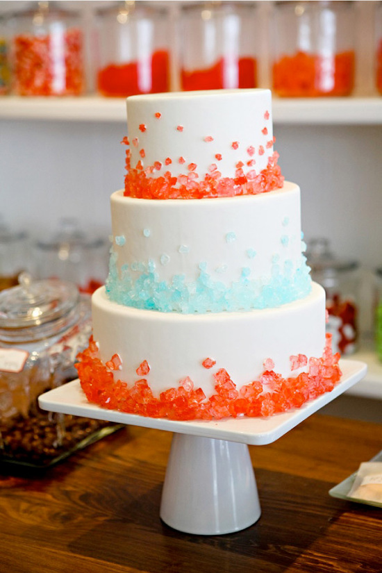 Classic wedding cake with pink and blue candy