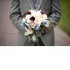 Wedding-photography-must-have-photos-groom-holds-brides-bouquet.square