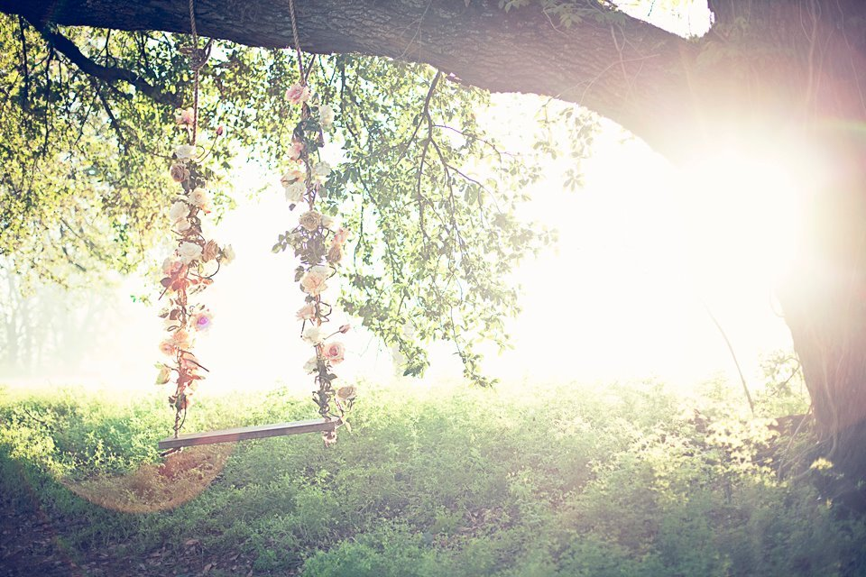 ethereal summer wedding ideas floral swing hanging from tree