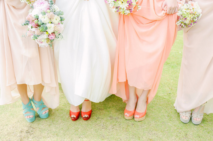 Summer bride with maids show off colorful shoes