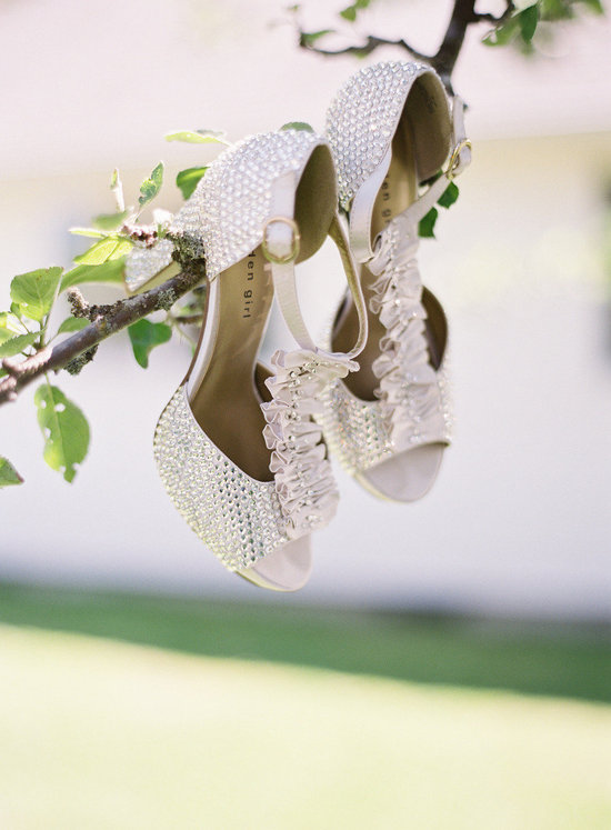 Crystal encrusted wedding shoes in the tree