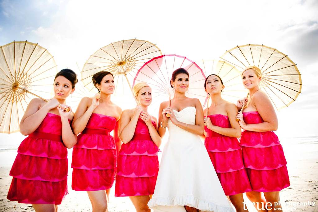 Hot pink short bridesmaid dresses with beach parasols